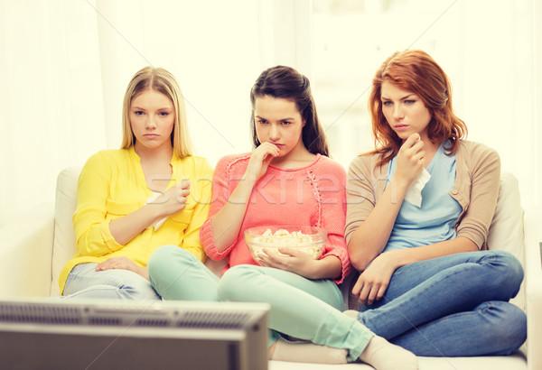 Stok fotoğraf: üç · üzücü · genç · kız · izlerken · tv · ev