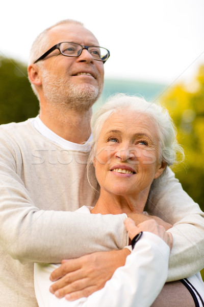 senior couple hugging in park Stock photo © dolgachov