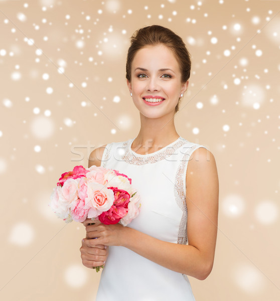 smiling woman in white dress with flowers Stock photo © dolgachov