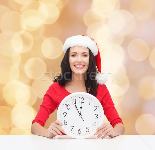 smiling woman in santa helper hat with clock Stock photo © dolgachov