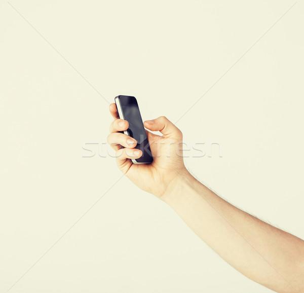 Stock fotó: Férfi · okostelefon · gépel · valami · közelkép · üzlet