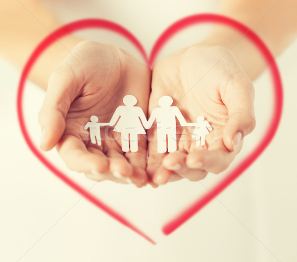womans hands with paper man family Stock photo © dolgachov