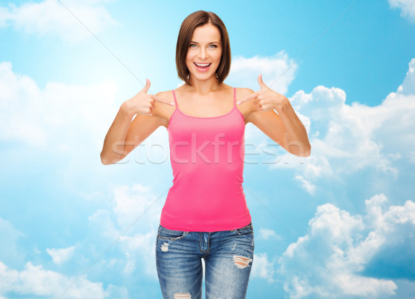 woman in blank pink tank top pointing fingers Stock photo © dolgachov