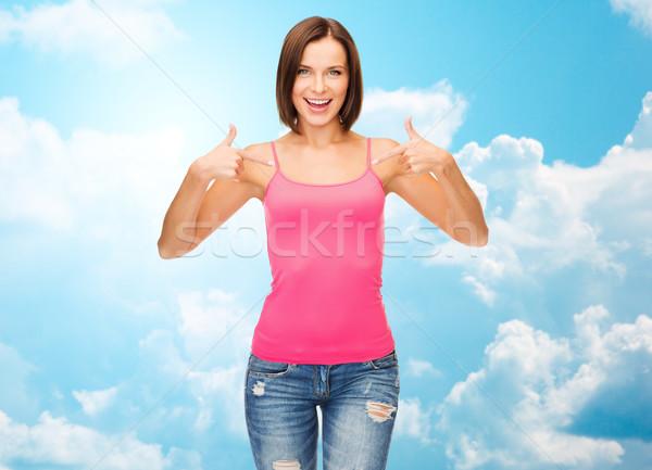 Kadın pembe tank üst işaret parmaklar Stok fotoğraf © dolgachov