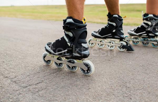 close up of legs in rollerskates skating on road Stock photo © dolgachov