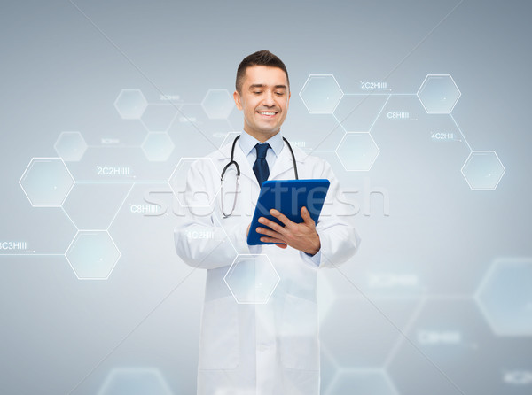 male doctor with tablet pc and chemical formula Stock photo © dolgachov