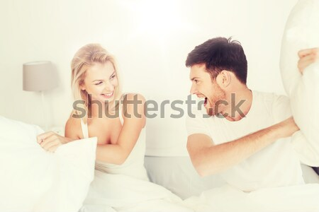 unhappy couple having problems at bedroom Stock photo © dolgachov