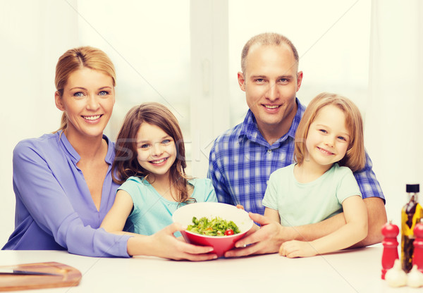 happy family with two kids with salad at home Stock photo © dolgachov