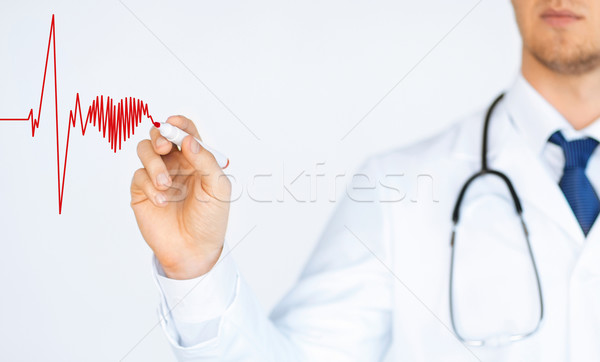 doctor drawing electrocardiogram on virtual screen Stock photo © dolgachov