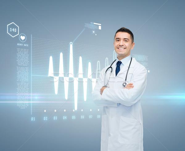 Médecin de sexe masculin cardiogramme écran santé cardiologie Photo stock © dolgachov