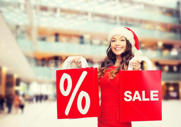 Stock fotó: Nő · vörös · ruha · bevásárlótáskák · vásár · ajándékok · karácsony
