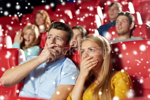 friends or couple watching horror movie in theater Stock photo © dolgachov