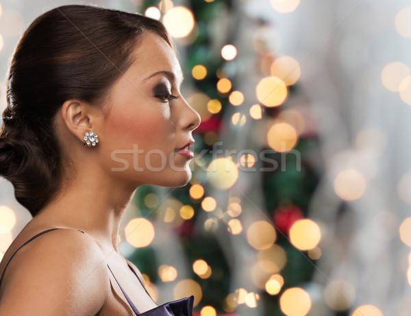Vrouw diamant oorbel christmas lichten mensen Stockfoto © dolgachov