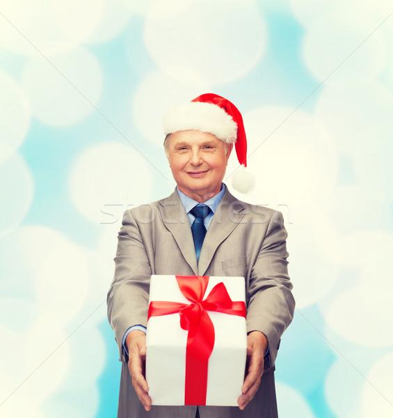Uśmiechnięty człowiek garnitur Święty mikołaj pomocnik hat Zdjęcia stock © dolgachov