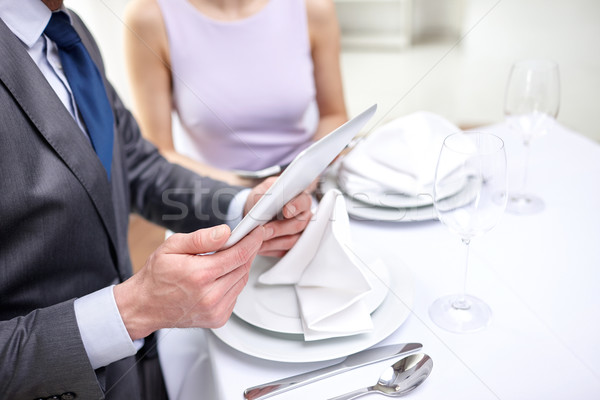 close up of couple with tablet pc at restaurant Stock photo © dolgachov