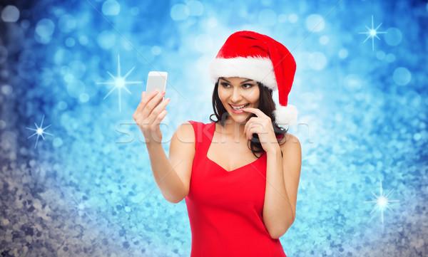 ストックフォト: 女性 · サンタクロース · 帽子 · スマートフォン · 人