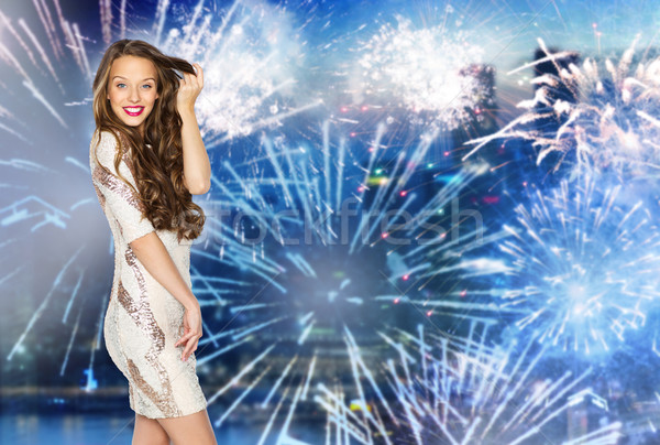 happy young woman or teen over firework at city Stock photo © dolgachov