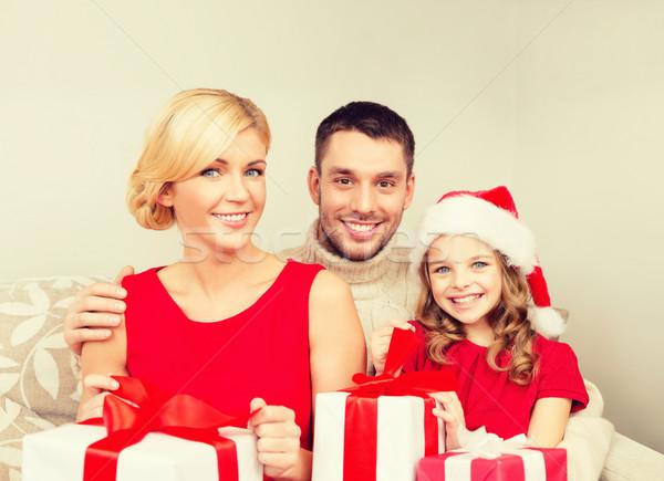 Mosolyog család tart sok ajándékdobozok karácsony Stock fotó © dolgachov