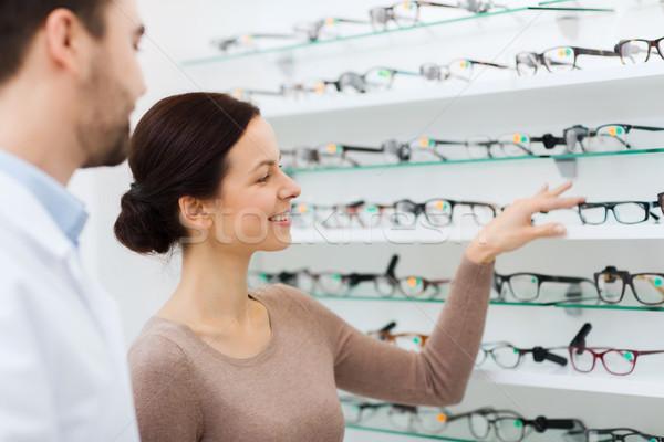 Mulher óculos oculista ótica armazenar Foto stock © dolgachov