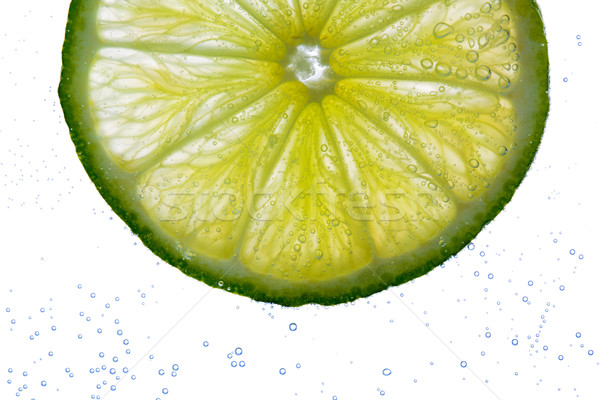 lime slice falling or dipping in water  Stock photo © dolgachov