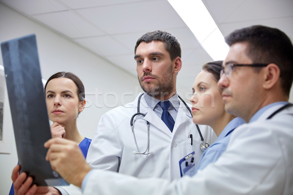 group of doctors looking at x-ray scan image Stock photo © dolgachov