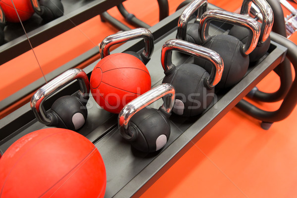 close up of kettlebells and medicine ball in gym Stock photo © dolgachov