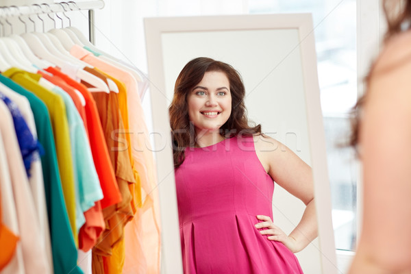 Stock photo: happy plus size woman posing at home mirror