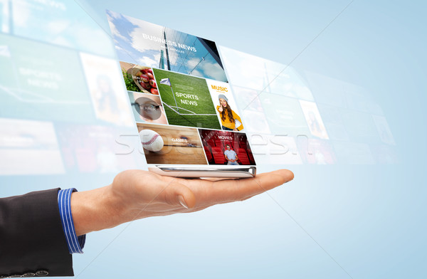 male hand with smartphone and web news projection Stock photo © dolgachov
