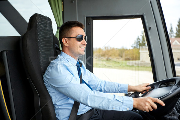 happy driver driving intercity bus Stock photo © dolgachov