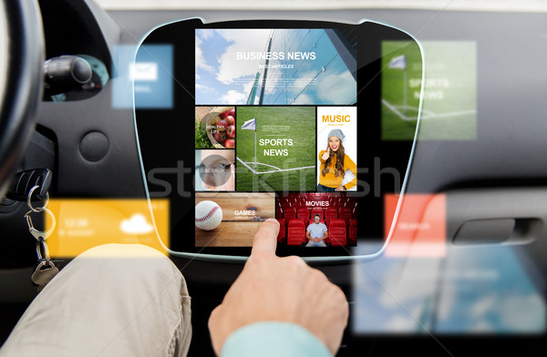 close up of male hand media applications in car Stock photo © dolgachov