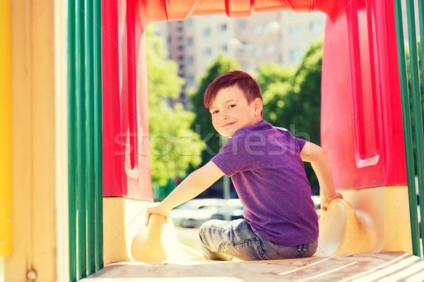 Feliz pequeno menino deslizar crianças recreio Foto stock © dolgachov