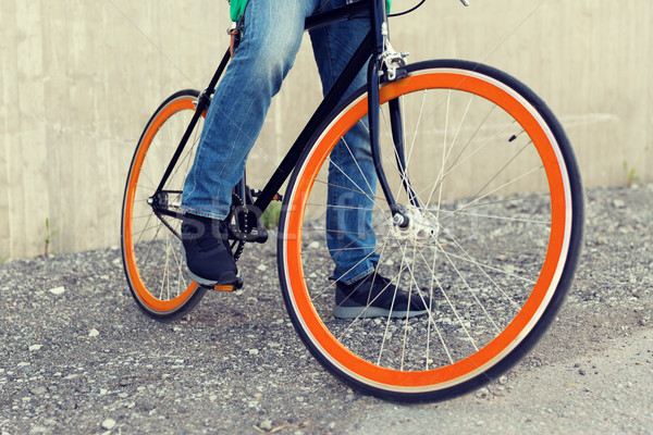 close up of man on fixed gear bike on city street Stock photo © dolgachov