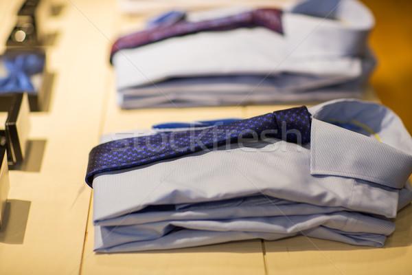 close up of shirts with ties at clothing store Stock photo © dolgachov
