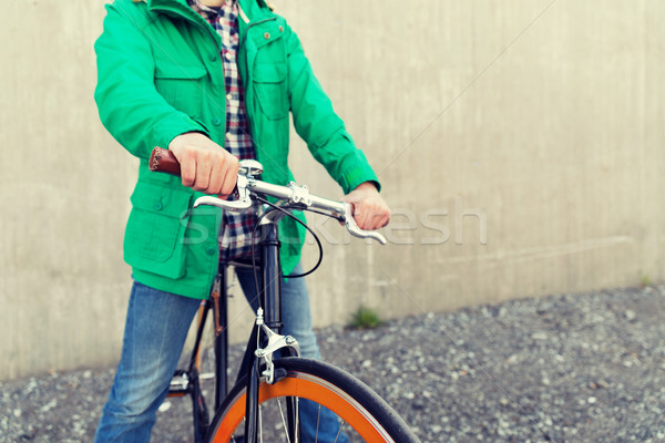 Stock photo: close up of man with fixed gear bike on street