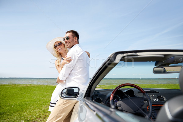 happy couple hugging near cabriolet car at sea Stock photo © dolgachov