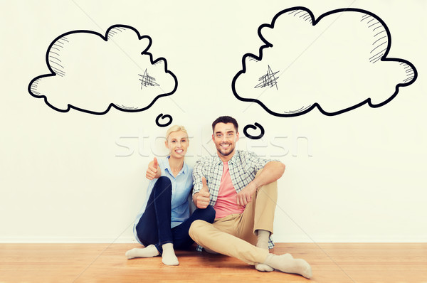 happy couple showing thumbs up at new home Stock photo © dolgachov