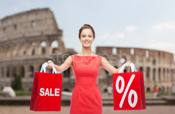 woman with red shopping bags over coliseum Stock photo © dolgachov