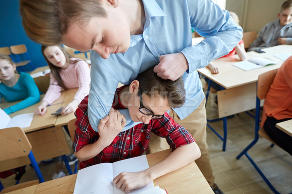student boy suffering of classmate mockery Stock photo © dolgachov
