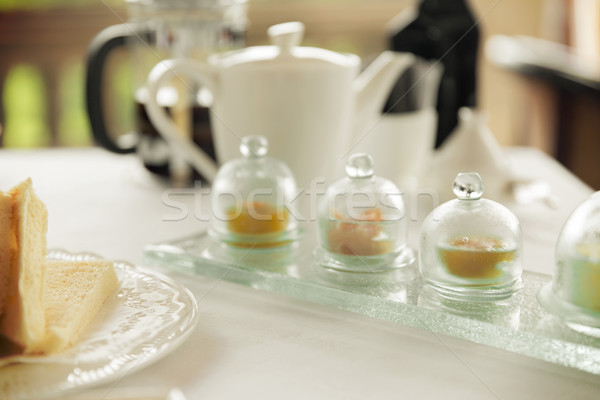 close up of tea time set with jam on table Stock photo © dolgachov