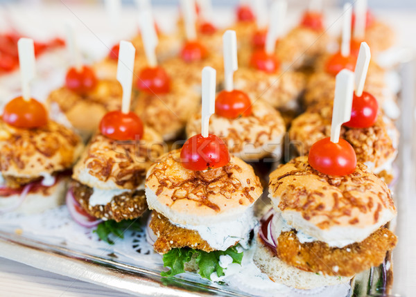 close up of canape hamburgers on serving tray Stock photo © dolgachov