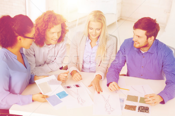 smiling creative team looking at sketch Stock photo © dolgachov