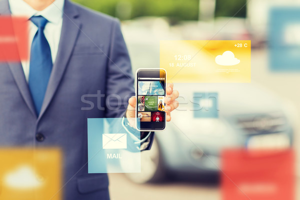 close up of business man with smartphone media Stock photo © dolgachov