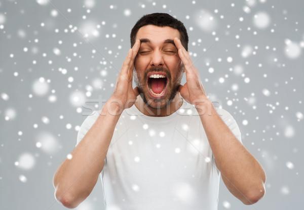 Crazy uomo tshirt neve emozioni Foto d'archivio © dolgachov