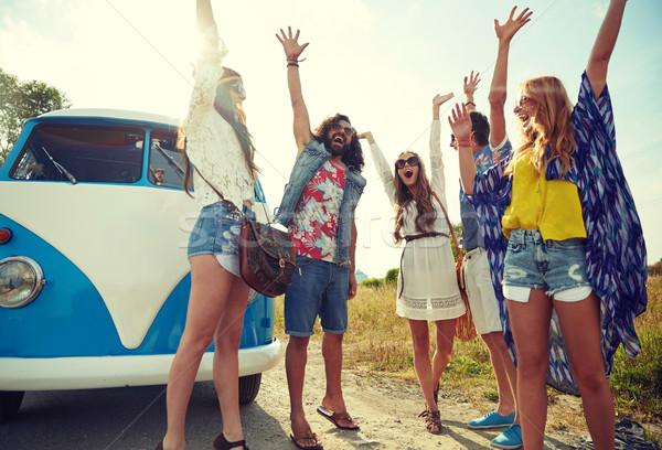 smiling hippie friends having fun over minivan car Stock photo © dolgachov
