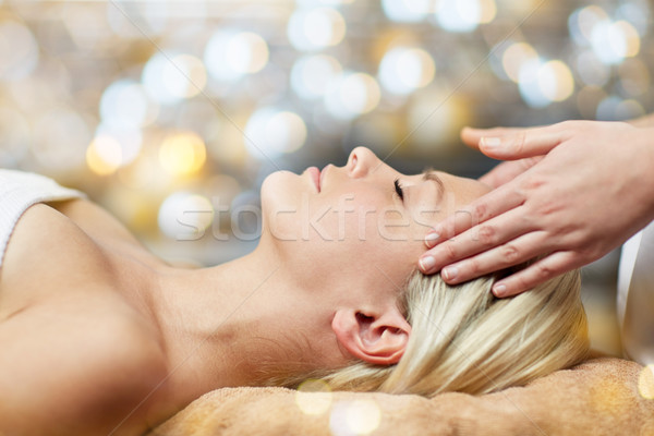 close up of woman having face massage in spa Stock photo © dolgachov