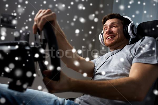 человека играет автомобилей Racing видеоигра домой Сток-фото © dolgachov