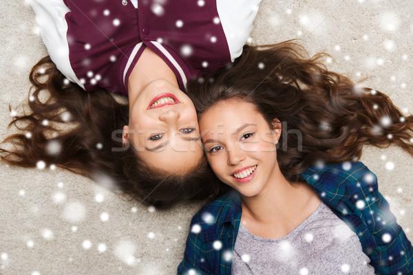 happy smiling pretty teenage girls lying on floor Stock photo © dolgachov
