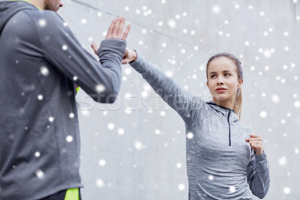 woman with coach working out strike outdoors Stock photo © dolgachov
