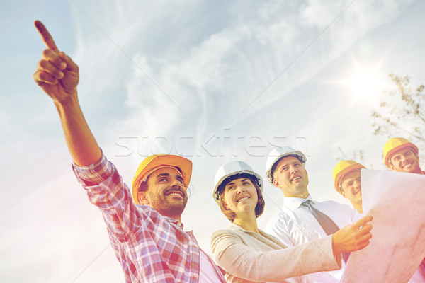 group of builders and architects with blueprint Stock photo © dolgachov