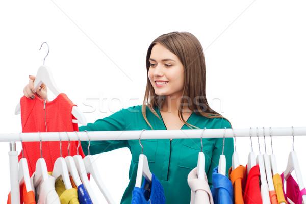 ストックフォト: 幸せ · 女性 · 服 · ホーム · ワードローブ